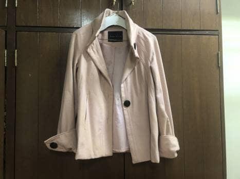 Abrigo rosa claro
