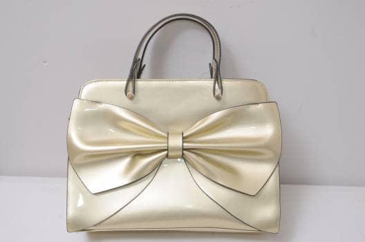 Bolsa dorado de moño