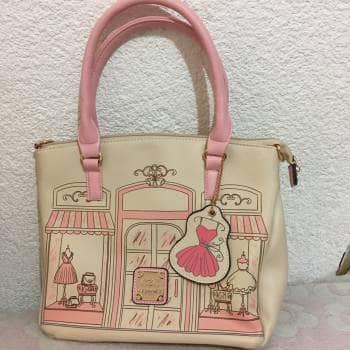 Bolsa de mano rosa estampado
